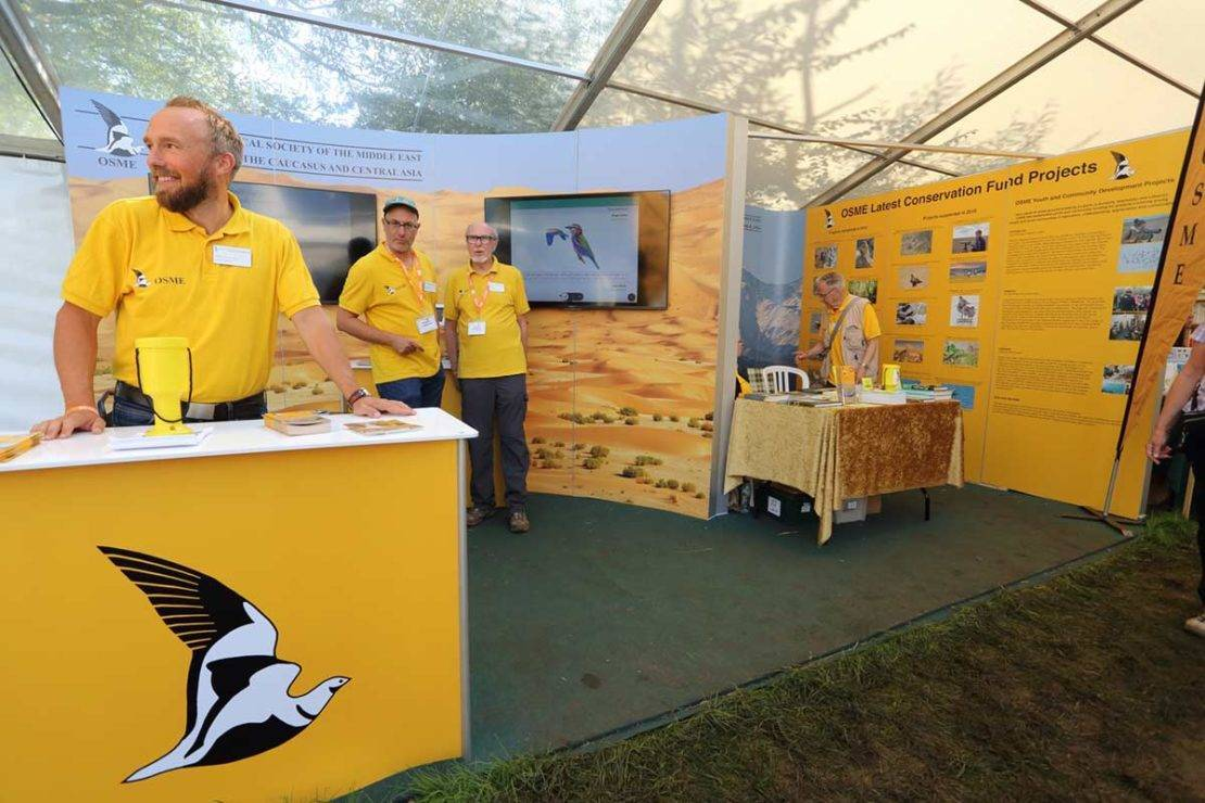 Plate 5. Setting up the OSME stand at the British Birdfair 2019. © Guy Shorrock